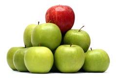 De concepten van de overheersing met appelen stock afbeeldingen