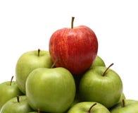 De concepten van de overheersing met appelen Stock Fotografie