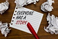De conceptuele hand die tonend iedereen heeft een Verhaal schrijven Bedrijfsfoto demonstratieachtergrond die vertellend uw geheug stock afbeelding