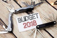 De conceptuele hand het schrijven inspiratie die van de teksttitel Begroting 2018 tonen Bedrijfsconcept voor Huishouden die boekh Stock Afbeelding