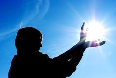 De controle van de mens de zon Stock Foto's