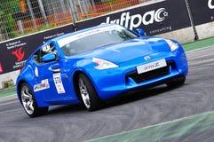 De coupé van Nissan 370Z bij de Afwijking 2010 van de Formule Stock Afbeelding