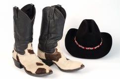 De Cowboy Boots van de koehuid en Hoed. Royalty-vrije Stock Fotografie