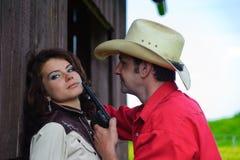 De cowboy met een pistool in handen stock foto