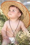 De cowboy van de baby in het hooi stock afbeeldingen