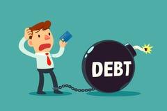 De creditcard van de zakenmanholding aan schuldtijdbom die wordt geketend Royalty-vrije Stock Afbeeldingen