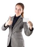 De creditcard van het vrouwenkostuum beduimelt omhoog Stock Foto's
