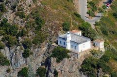 De d'Elba-vuurtoren van Isola in Punta Polveraia Stock Afbeeldingen