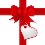 De dag van de huidige Valentijnskaart met rode boog Royalty-vrije Stock Afbeeldingen