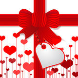 De dag van de valentijnskaart huidig met rode boog Stock Afbeeldingen