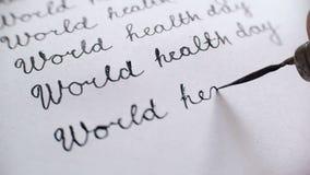 De dag van de wereldgezondheid kalligrafie en het lattering De tiende audio van het lijnclose-up whith stock video
