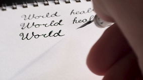 De dag van de wereldgezondheid kalligrafie en het lattering Derde lijn Close-up stock video