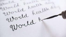 De dag van de wereldgezondheid kalligrafie en het lattering Elfde lijn whith audio stock footage
