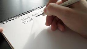 De dag van de wereldgezondheid kalligrafie en het lattering Tweede lijn stock videobeelden