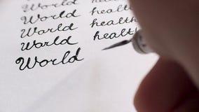 De dag van de wereldgezondheid kalligrafie en het lattering Zesde lijnclose-up stock videobeelden