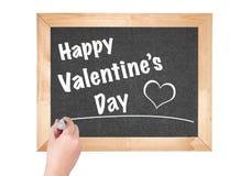 De dag van gelukkig die Valentine de uitdrukking op het bord wordt geschreven Royalty-vrije Stock Fotografie