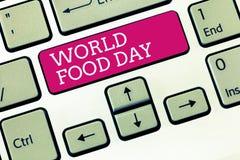De Dag van het de Wereldvoedsel van de handschrifttekst Concept die Werelddag van actie gewijd aan het aanpakken van globale hong stock foto's