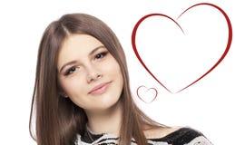 De Dag van valentijnskaarten. Mooie meisjestiener met hart Stock Foto