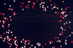 De dagachtergrond van valentijnskaarten met harten Stock Afbeelding