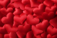 De dagachtergrond van valentijnskaarten met rode harten royalty-vrije stock foto's