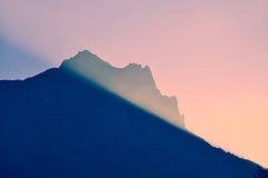 De dageraad van de zonnestraal   stock fotografie