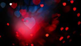 De daghart gestalte gegeven bokeh achtergrond van abstract Valentine in rode en blauwe tonen stock footage