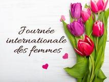 De dagkaart van vrouwen met Franse woorden ` Journée internationale des femmes ` royalty-vrije stock afbeeldingen