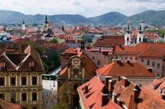 De daken van Graz Stock Afbeeldingen
