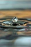 De daling van het water en waterringen Stock Foto's