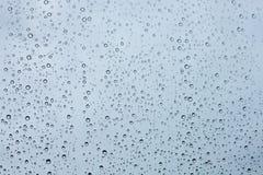 De daling van het water op de achtergrond van de glazentextuur Stock Foto's
