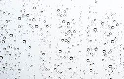 De daling van het water op glas Stock Foto