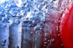 De dalingen en de chemieglas van het water Stock Foto