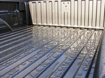 De dalingen van de regen op de bedoppervlakte van een nieuw voertuig. Royalty-vrije Stock Afbeelding