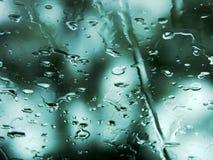 De dalingen van de regen op een venster Stock Fotografie
