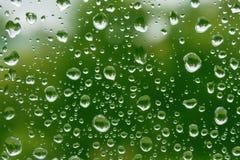 De dalingen van de regen op glasvenster Royalty-vrije Stock Foto
