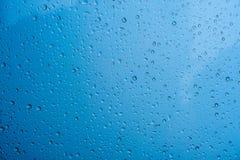 De dalingen van de textuurregen op het glas Royalty-vrije Stock Foto
