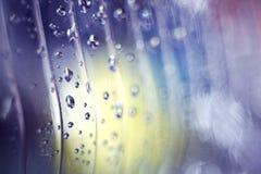 De dalingen van het textuurwater op het plastiek Royalty-vrije Stock Foto's