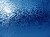 De Dalingen van het water op de Oppervlakte van het Glas Royalty-vrije Stock Foto's