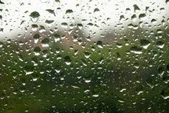 De dalingen van de regen op het glas Stock Fotografie