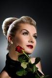 De dame met rood nam toe Royalty-vrije Stock Foto's