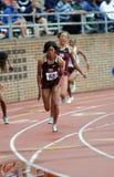 De Dames 4x100 van Texas A&M lossen weg hand af Stock Foto's