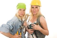 de dames van de teamcontractant met hulpmiddelen Stock Foto's