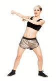 De danser van de Zumbageschiktheid De mannequin van het blondehaar op witte achtergrond royalty-vrije stock afbeeldingen