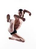 De dansers gymnastiek- sprong van de mens Stock Afbeeldingen