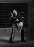 De dansers van de tango in actie Stock Afbeeldingen