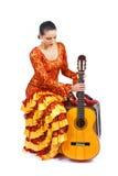 De danserszitting van het flamenco met gitaar Stock Foto's