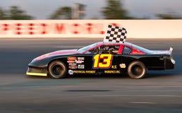 De de autobestuurder Greg Dowe van de voorraad wint race in SpeedWorld stock afbeeldingen