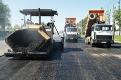 De de bestratingswerken van het asfalt Stock Foto's