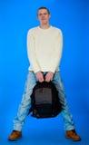 De de dragende zak en boeken van de student in rug Royalty-vrije Stock Foto