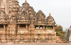 de 10de eeuw Hindoese tempel Kandariya Mahadeva, structuur van het complex van Khajuraho Stock Foto